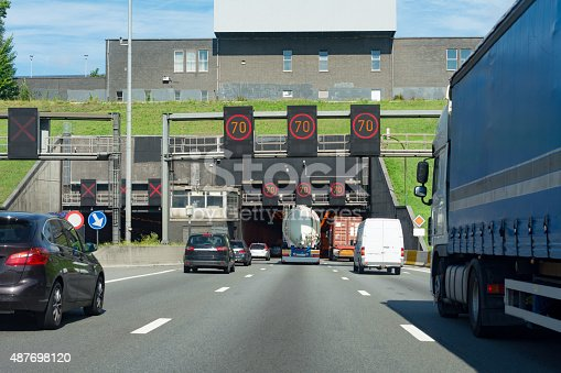istock Overtaking   a large blue truck in the Kennedy Tunnel Antwerp 487698120