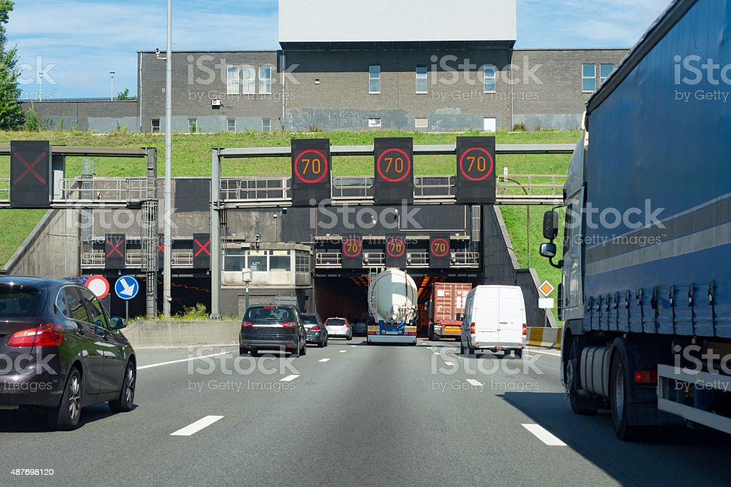 Overtaking   a large blue truck in the Kennedy Tunnel Antwerp stock photo