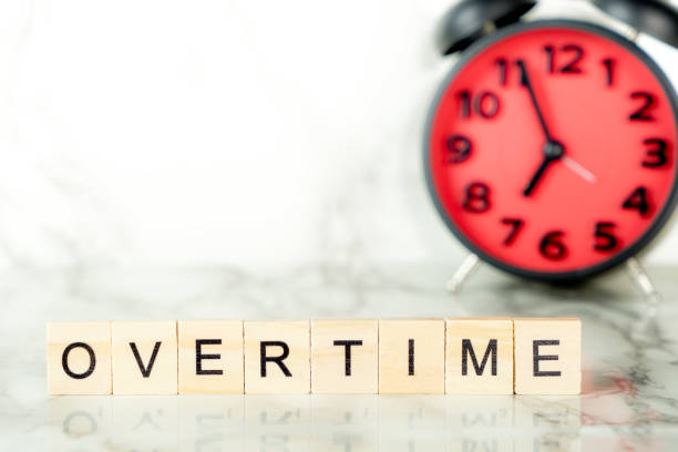 Overtime clock with text on marble copy space stock photo