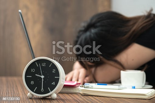 istock Overtime work. Exhaused female in office. 861233130
