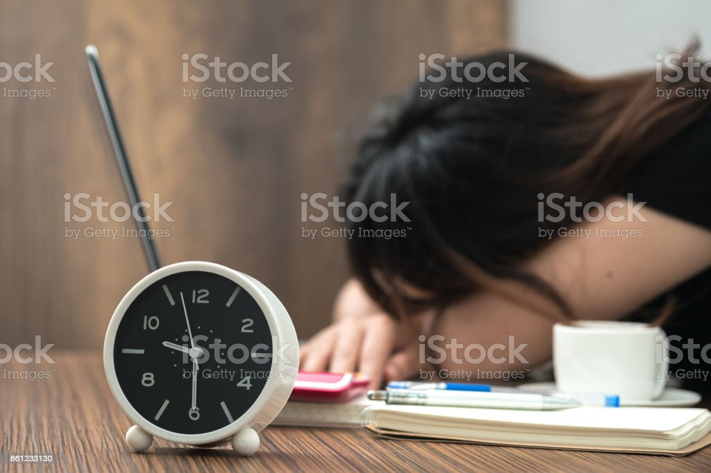 Overtime work. Exhaused female in office. stock photo