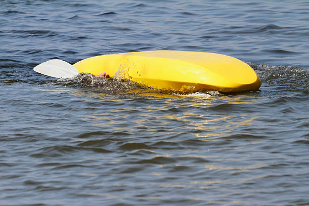 Overturned Kayak With Only a Hand Visible stock photo
