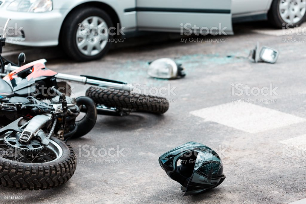 Overturned motorcycle after collision stock photo