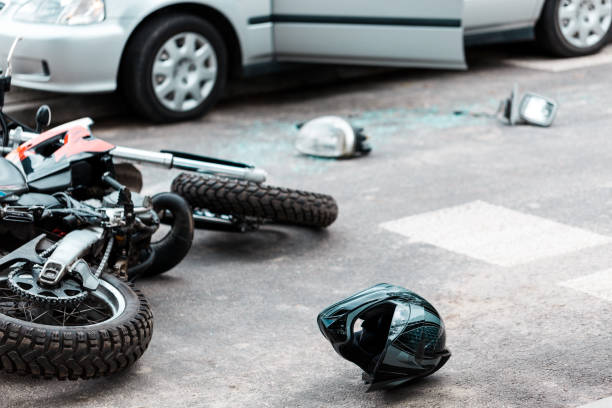 Overturned motorcycle after collision Overturned motorcycle and helmet on the street after collision with the car misfortune stock pictures, royalty-free photos & images