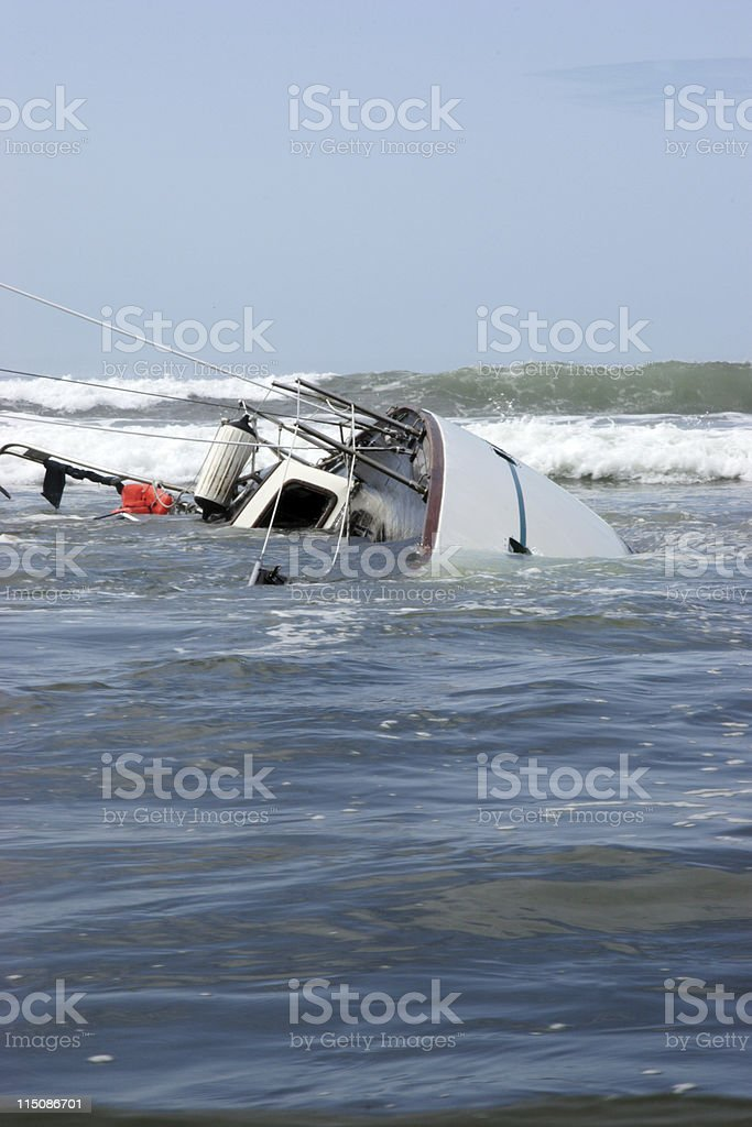 overturned sunk sailboat royalty-free stock photo