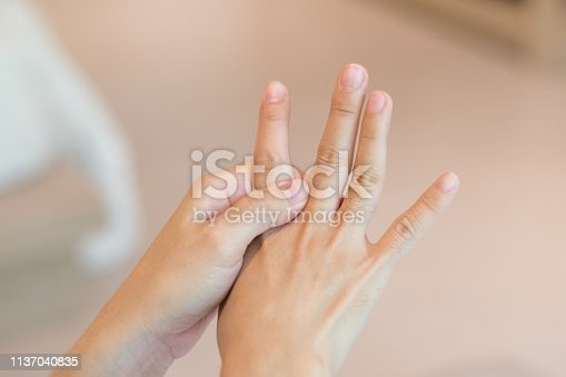 668285874istockphoto Overuse hand problems. Woman hand with red spot o fingers as suffer from Carpal tunnel syndrome. The symptoms of tingling, numbness, weakness, or pain of the fingers and wrist. 1137040835