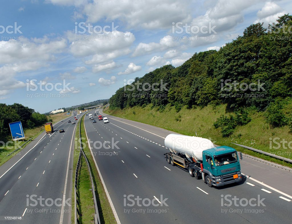 Overview of chemical tanker speeding down the highway stock photo