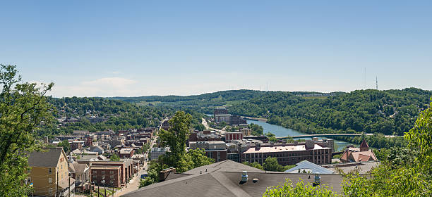 Overview of City of Morgantown WV View of the downtown area of Morgantown WV and campus of West Virginia University monongahela river stock pictures, royalty-free photos & images