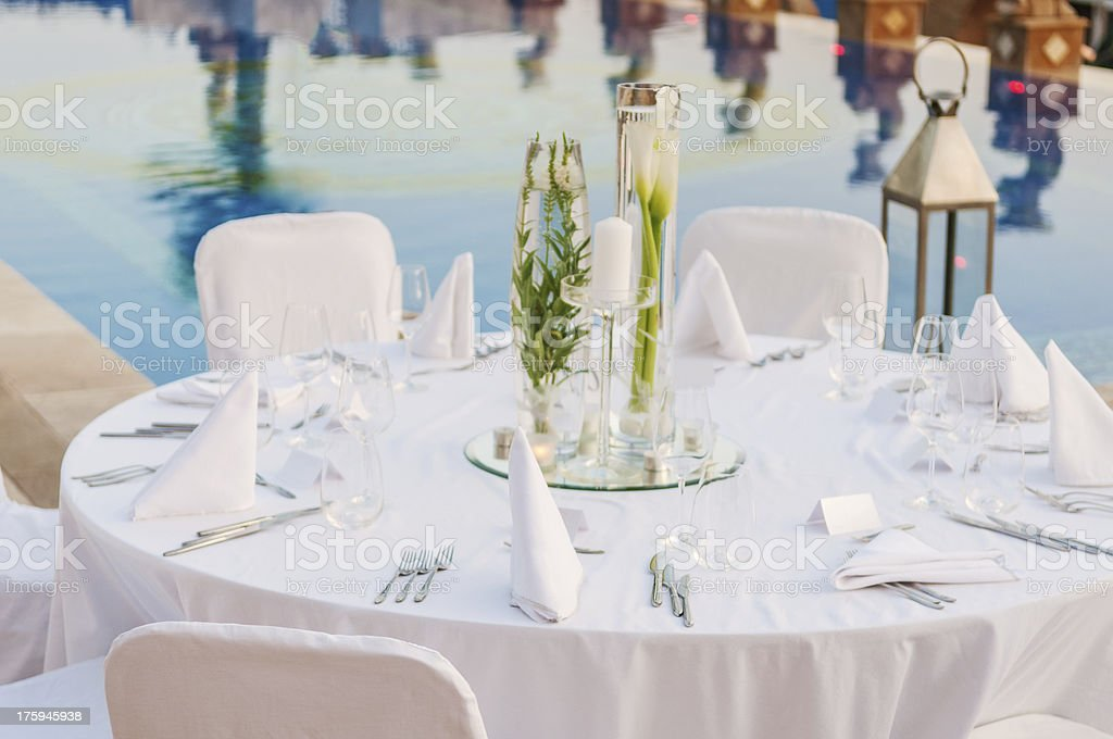 Overview of elegant white wedding reception table setting stock photo