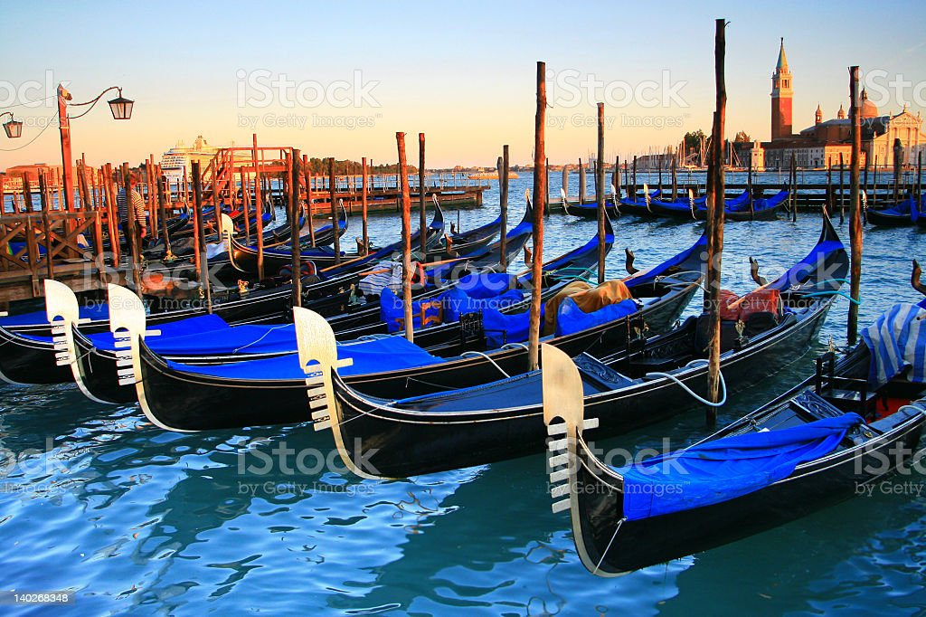 Overview of gondolas docked at harbor in Venice royalty-free stock photo