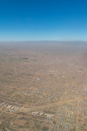istock Overview of the city of El Alto, the second city of Bolivia after La Paz. Built spontaneously in the Andean high plateau, it is 4150 meters high. 1056591418