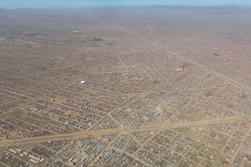 istock Overview of the city of El Alto, the second city of Bolivia after La Paz. Built spontaneously in the Andean high plateau, it is 4150 meters high. 1056591434