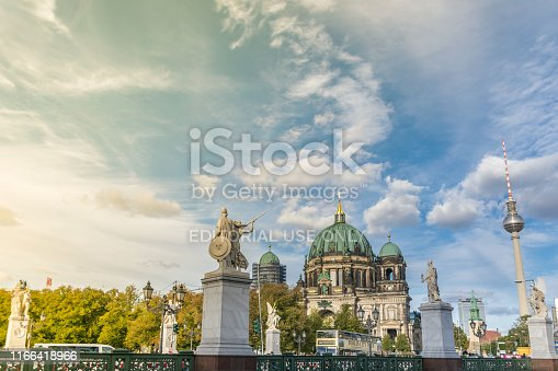 BERLIN, GERMANY - July 28, 2018: Overview of three important landmarks of the Berlin history: the Schloss brigde and its imperial statues, the Evangelical Cathedral of Berlin and the modern TV tower.