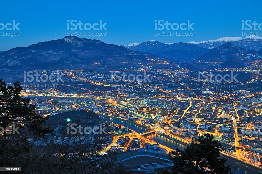 Overview of Trento in night time stock photo