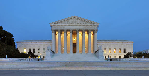Overview of United States Supreme Court building Panorama of the United States Supreme Court at dusk in Washington DC, USA. us supreme court building stock pictures, royalty-free photos & images