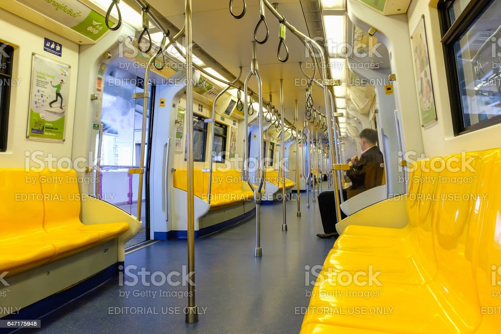 Overview of yellow seats in electric train stock photo