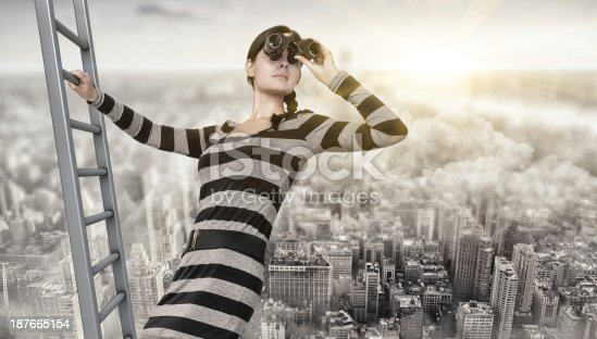 woman with a spyglass stands on top of a ladder