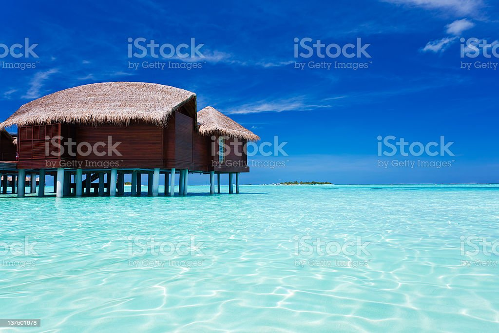 Overwater bungalow in lagoon around tropical island royalty-free stock photo