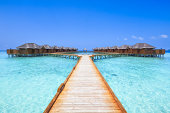 overwater bungalows boardwalk of the Maldives