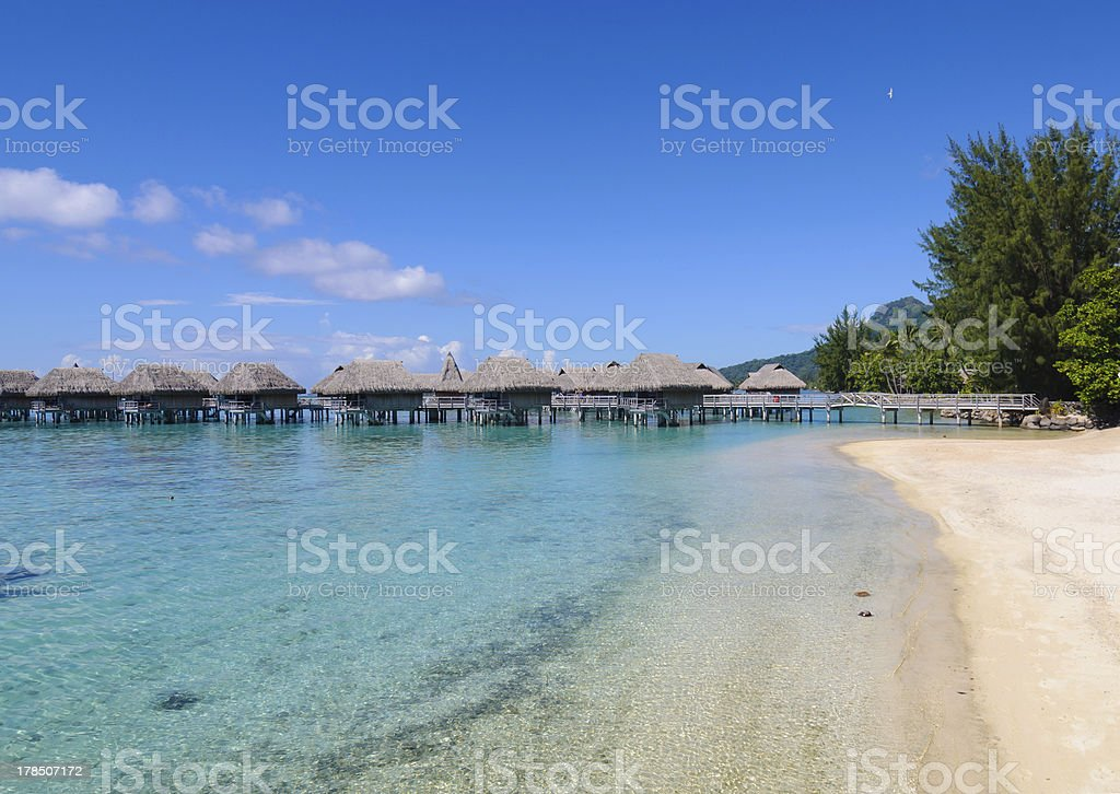 Overwater Bungalows over clear blue Ocean stock photo
