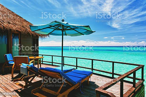 Overwater Villa Balcony Overlooking Tropical Lagoon Stock Photo - Download Image Now