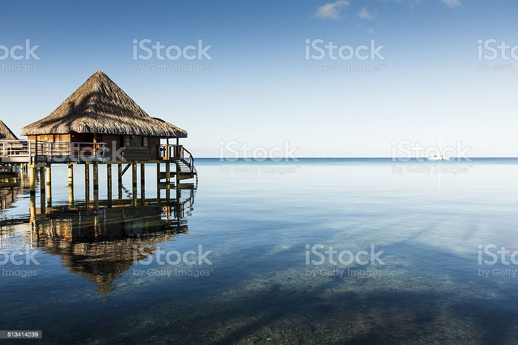 Overwater Woody Bangalow Over Crispy Clear Water stock photo