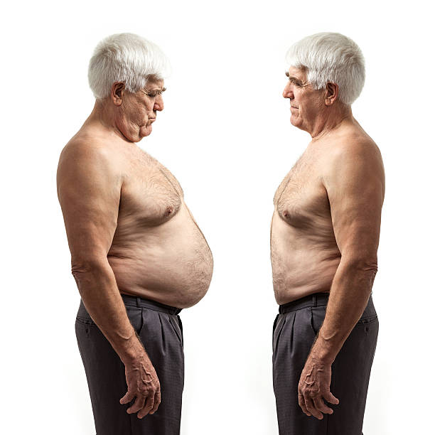 Overweight and regular weight men over white stock photo
