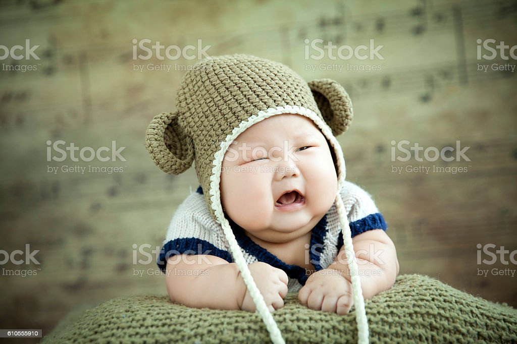 Overweight baby crying stock photo