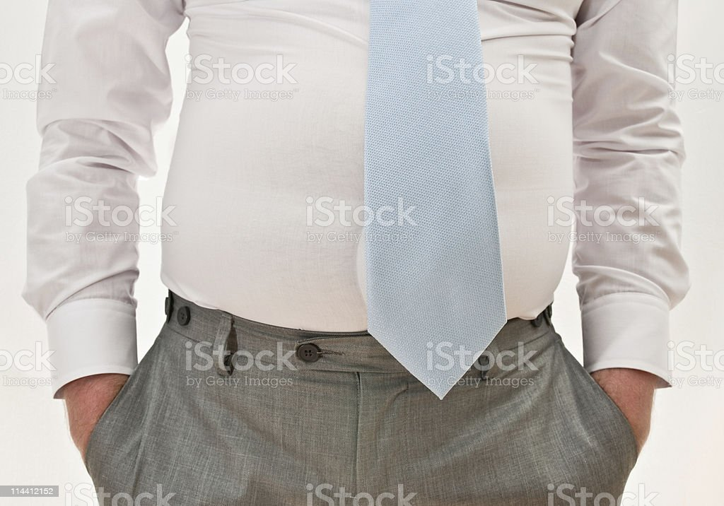overweight businessman with hands in pockets royalty-free stock photo