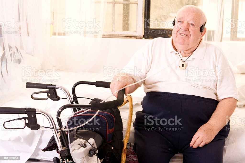 Overweight elderly man on oxygen royalty-free stock photo