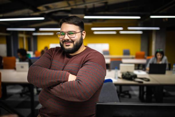 Overweight entrepreneur in modern office stock photo