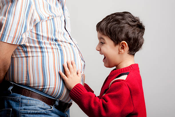 Overweight father and son stock photo