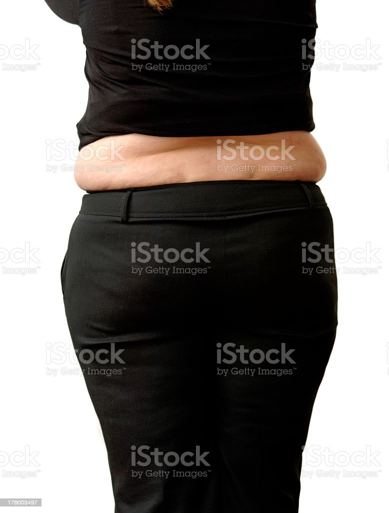 Overweight lady standing from rear against white royalty-free stock photo