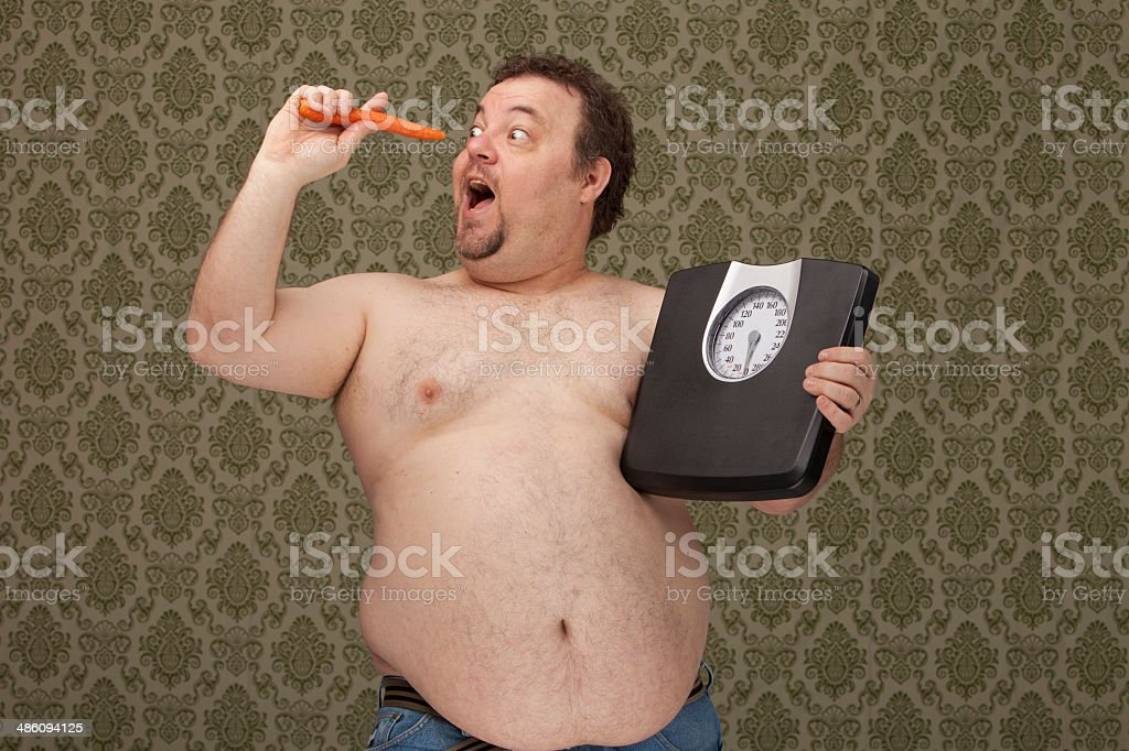 overweight male making healthy choices stock photo