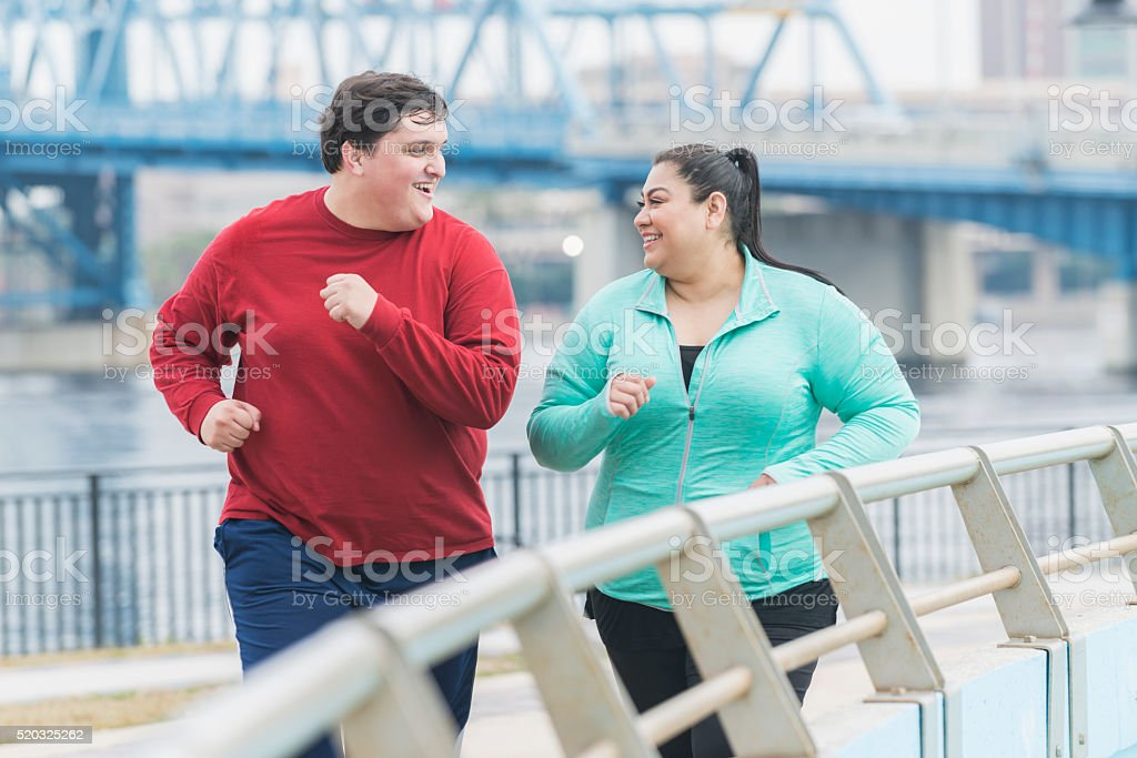 An overweight Hispanic woman and a young mixed race Hispanic and...