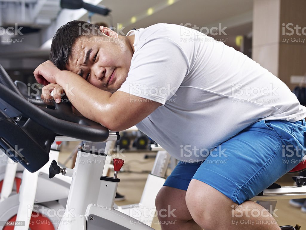 overweight man exercising stock photo