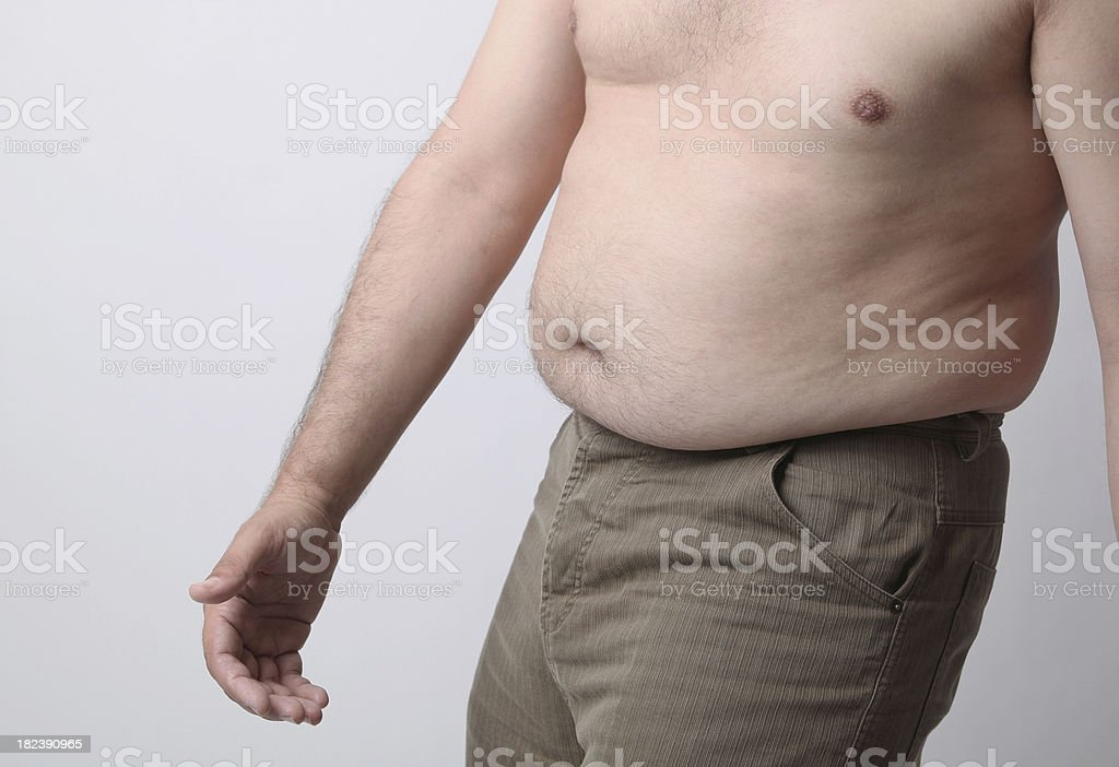 \'Side view of an overweight, middle-aged man naked from the waist up\'