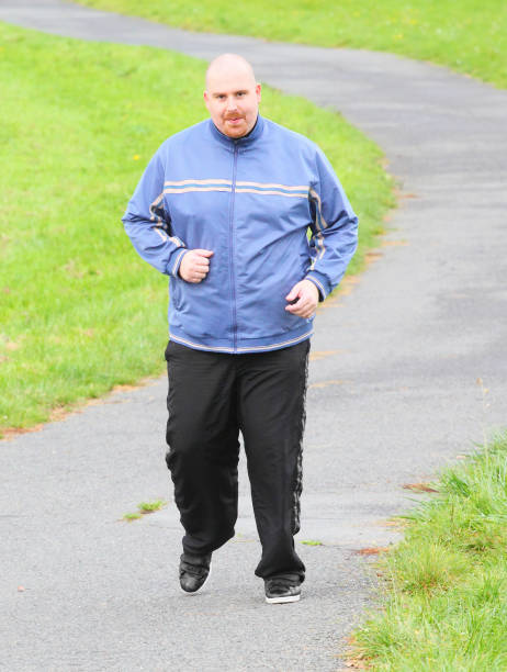 Übergewichtiger Mann laufen. – Foto