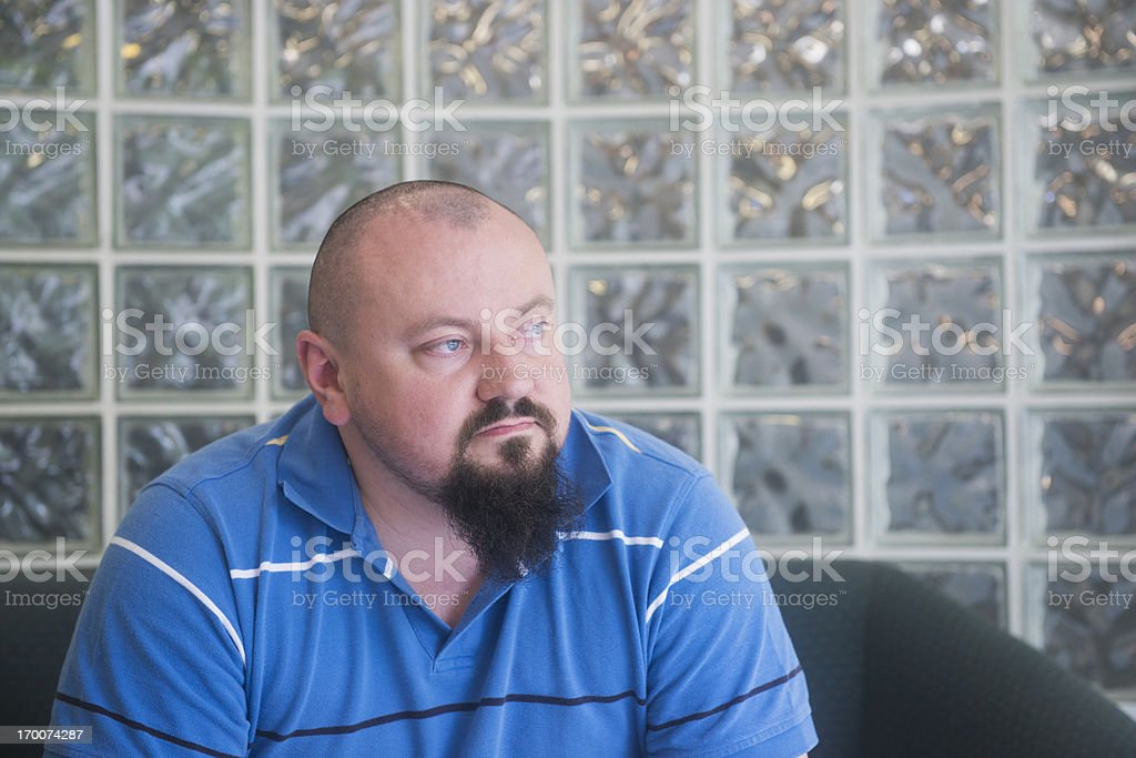 Overweight Man Waiting to See a Doctor royalty-free stock photo