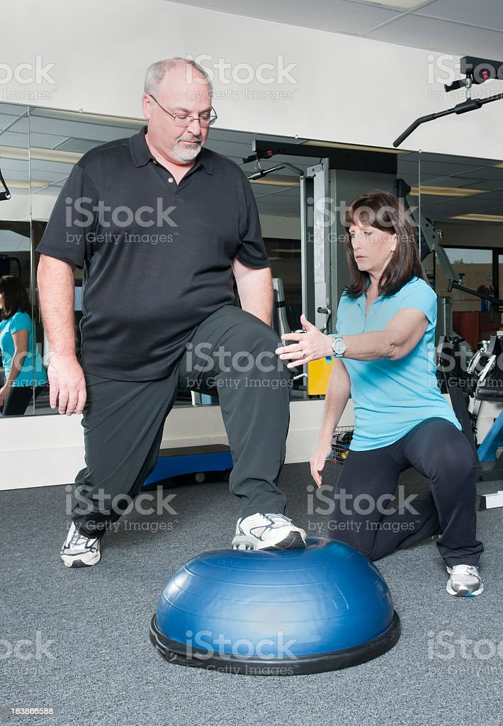Overweight Man Working Out With Personal Trainer royalty-free stock photo