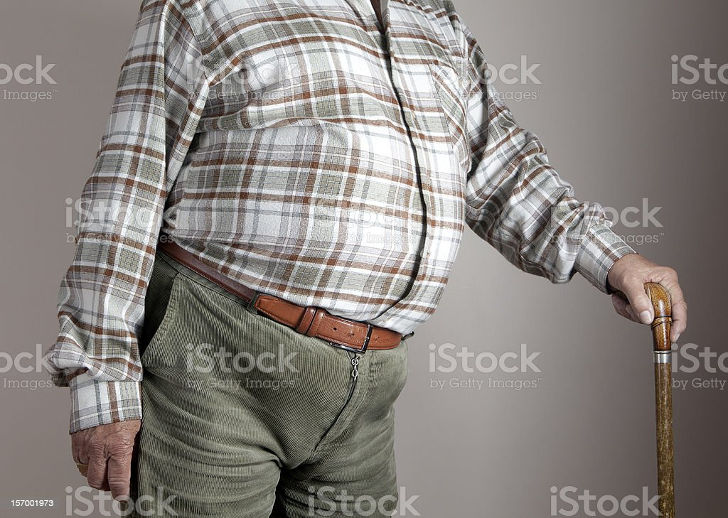 Side view of a fat belly, holding walking stick.