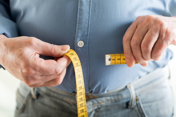 overweight - measuring stock pictures, royalty-free photos & images