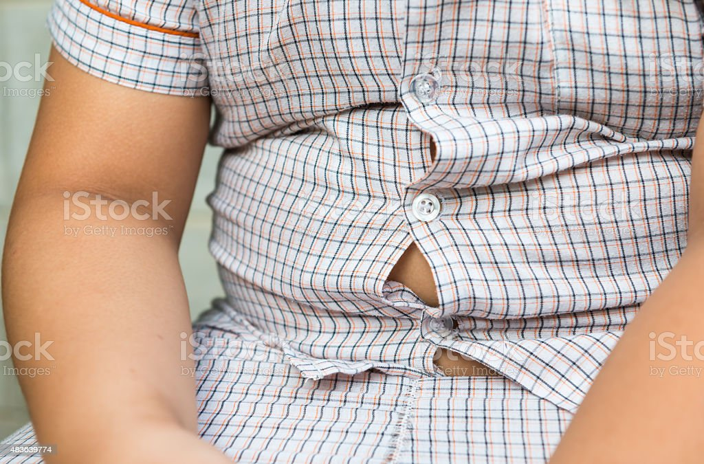 Overweight. Tight shirt. stock photo