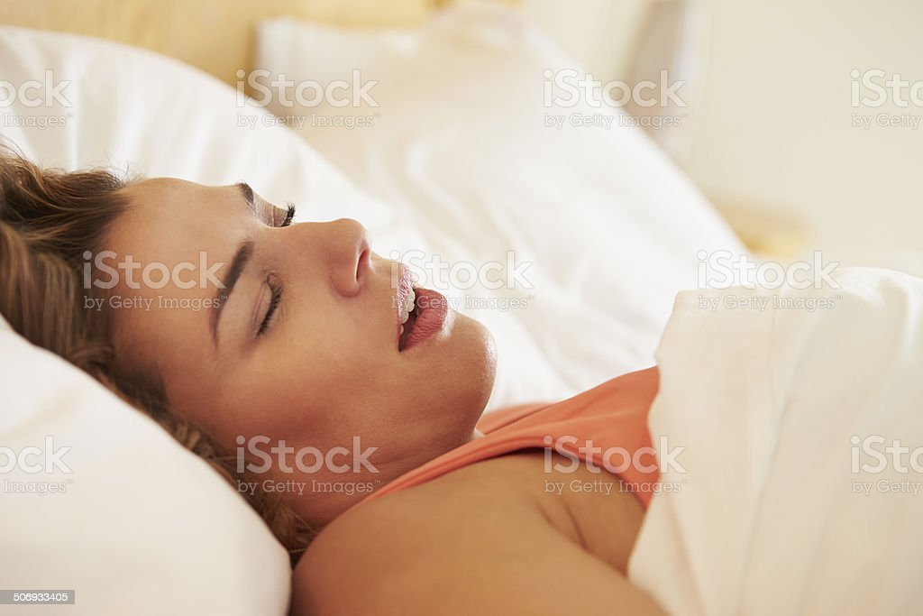 Overweight Woman Asleep In Bed Snoring stock photo