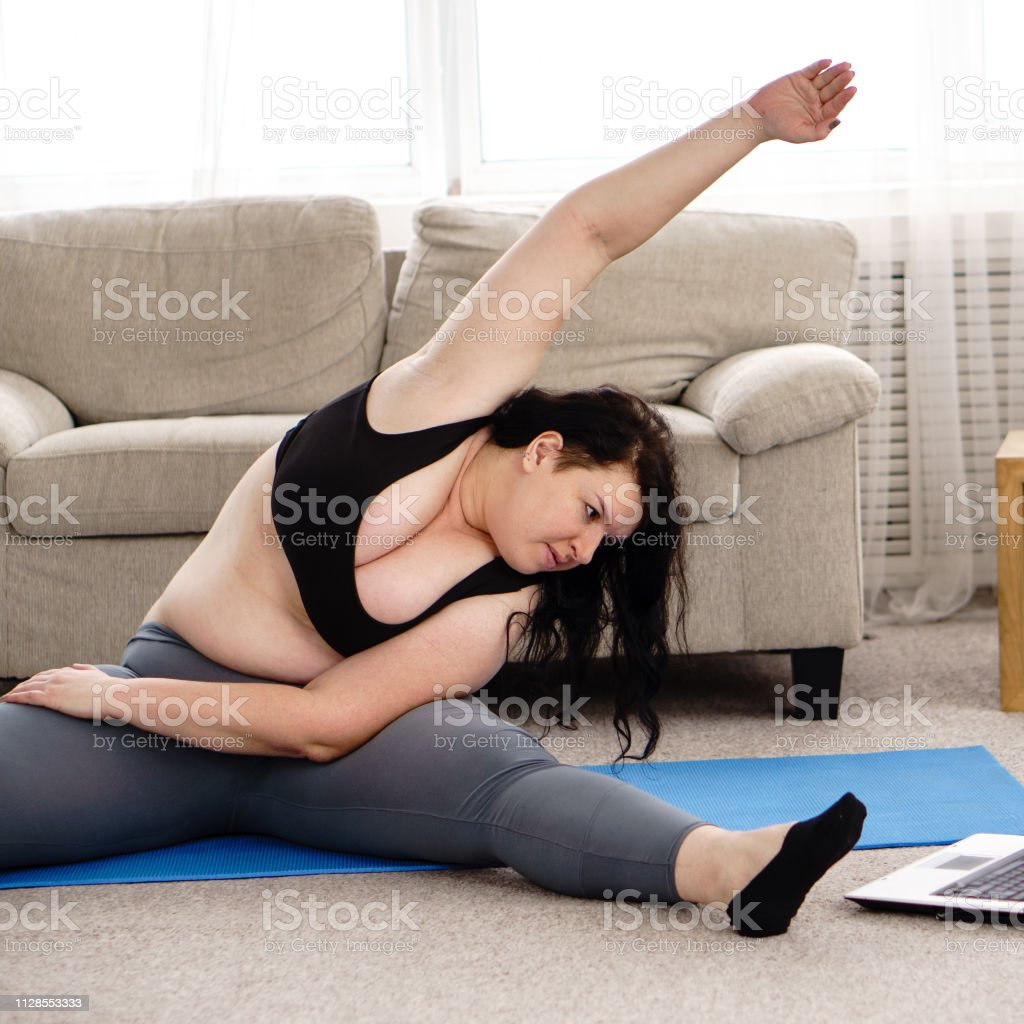 Overweight Woman Doing Yoga Exercise Home Workout Stock Photo Download Image Now Istock