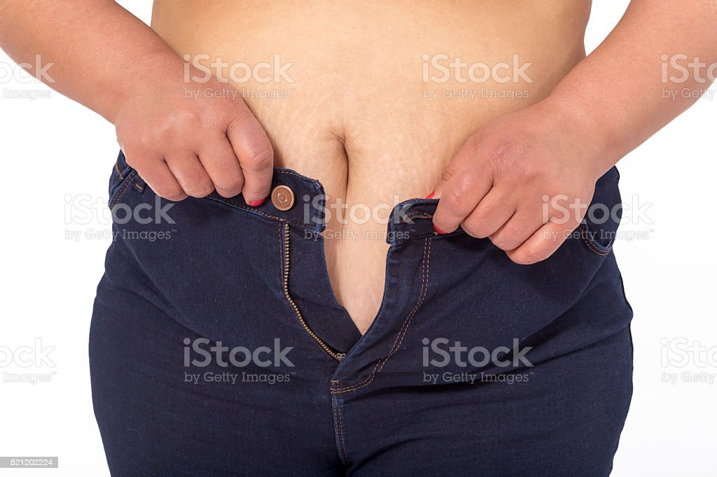 Overweight woman in fit jeans stock photo