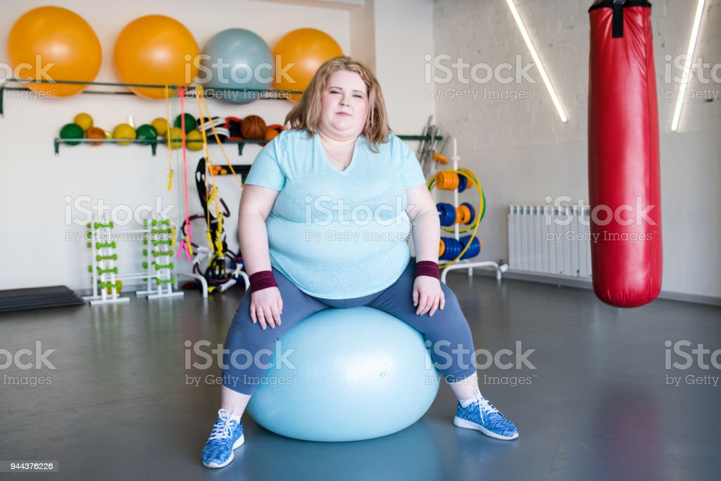 overweight Woman in Fitness Club stock photo