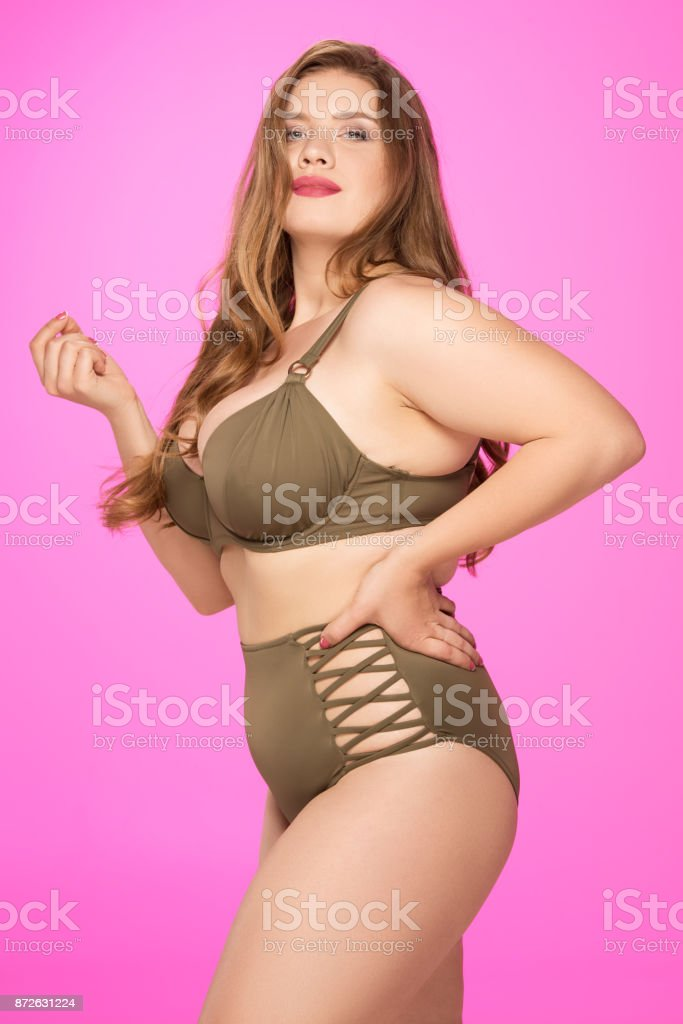 overweight woman in swimsuit stock photo