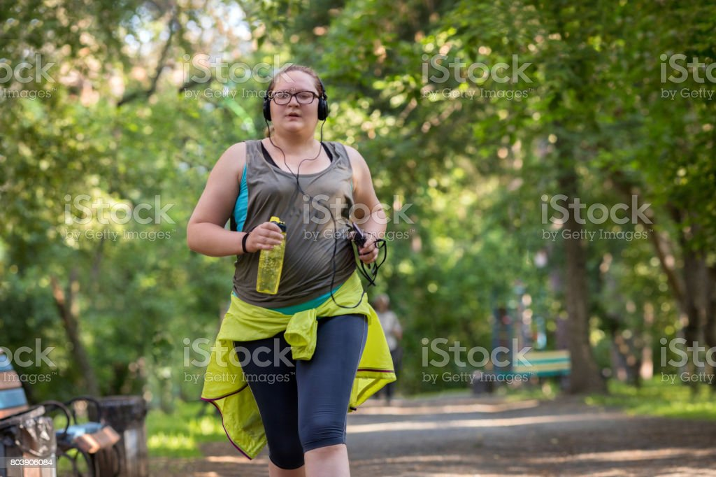 Overweight woman running. Weight loss concept. stock photo