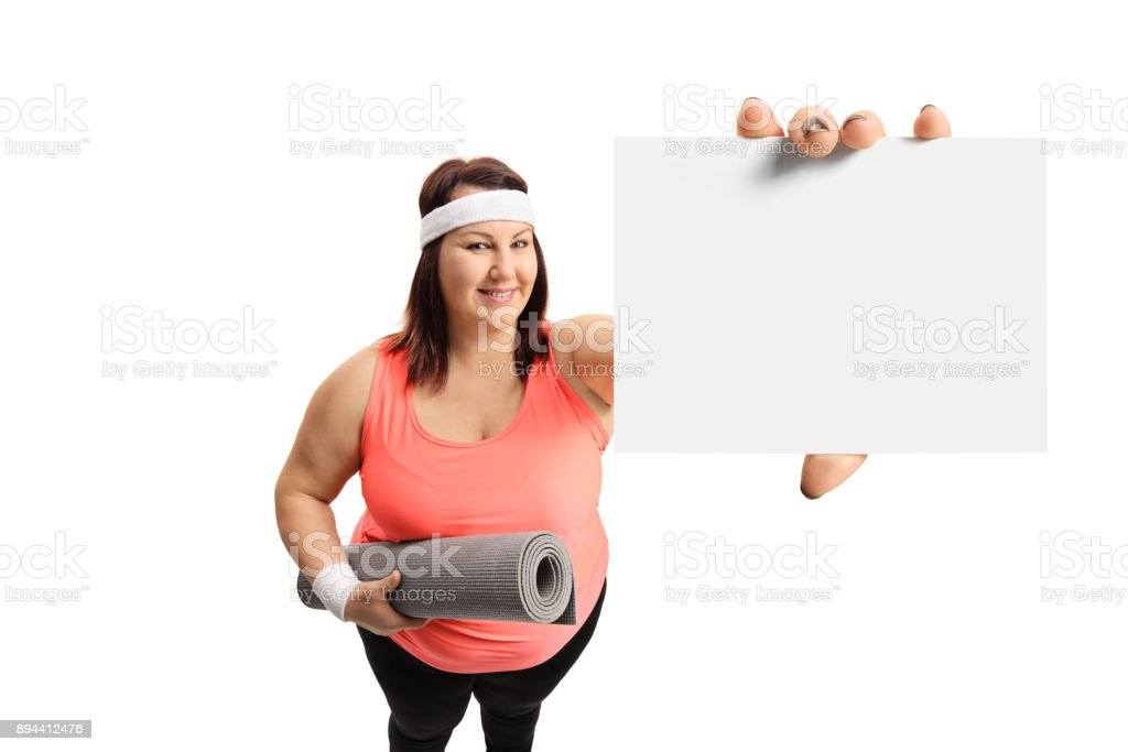 Overweight woman showing a blank card stock photo